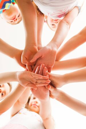 Bottom view of pupils putting their hands Stock Photo