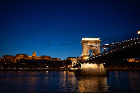 Hungarian Chain bridge, Royal palace and Danube river in Budapest at night 스톡 콘텐츠