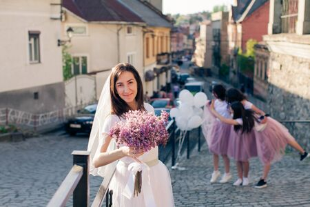 Beautiful bride with her bridesmaids enjoing hen party 免版税图像