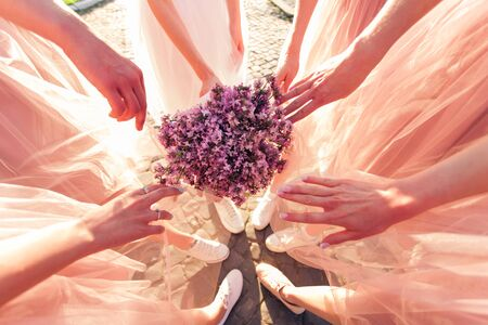 Girlfriends and bride holding lilac flowers bouqet 免版税图像