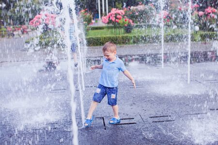Little boy trying to stop the flow of water