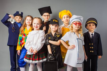 Group of school children dressing up as professions. Future education.