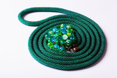 Top view green lariat chain in twisted in spiral