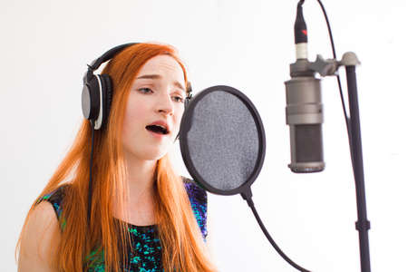 The beautiful woman professionally performs a song