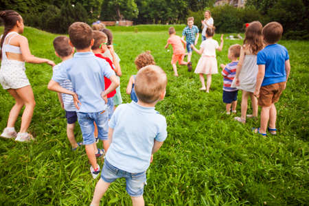 Physical education lesson for children in the summer park Standard-Bild