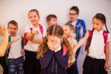 The girl suffers from bullying by peers at school