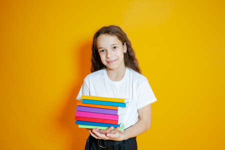 The schoolgirl with positive emotions prepares for school Standard-Bild