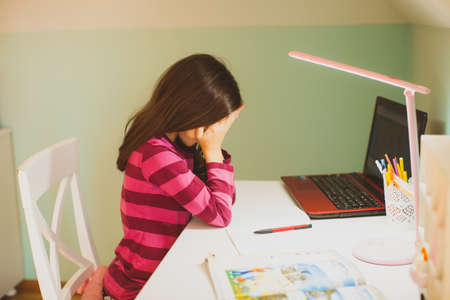 The upset schoolgirl who finds it difficult to study online