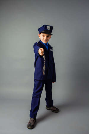 The little policeman stands guard over the law