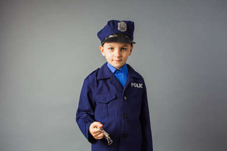 The little boy likes the profession of a policeman