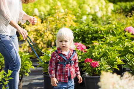 Safe walk with parents outdoors at botanical garden