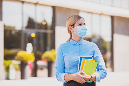 The student follows safety rules during a coronavirus epidemic