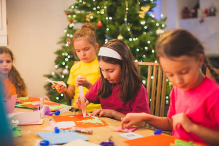 Cooperation and support between kids while Christmas workshop