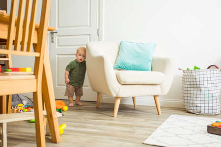 Toddler boy learns to communicate with new people