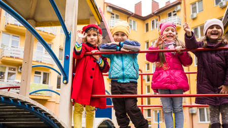 Group of kids walking on the playground Imagens