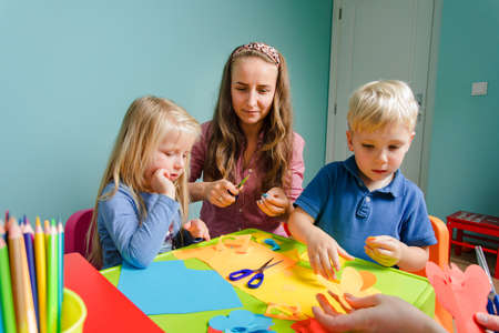 children and tutor study together at the creative school