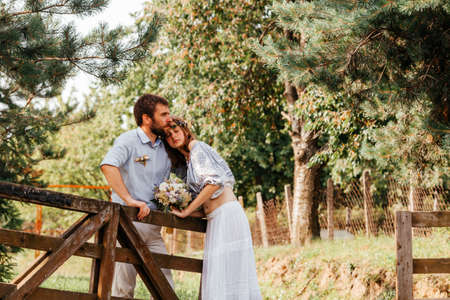 Eclectic rustic wedding couple. Intimate ceremony at backyard