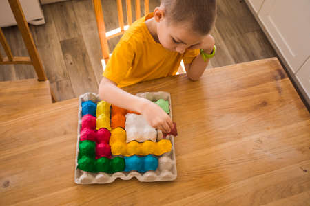 Colorful puzzle made of multi-colored egg tray