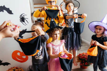 Group of kids waiting for Halloween candies