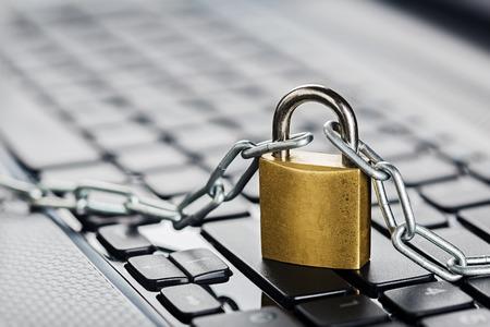 Padlock on computer keyboard. Network Security, data security and antivirus protection PC. Standard-Bild
