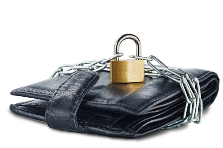 Leather wallet with lock and chain on white isolated background. Concept of protecting electronic money and safety personal finances. Financial  security  in cashless and cash settlements.
