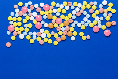 Medical tablets. On a blue background. View from above . The concept of medicine