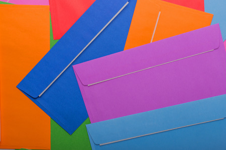 Many postal color envelopes.Background of beautiful envelopes for designers. Standard-Bild