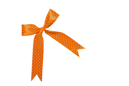 Orange bow with white polka dots. For designers.