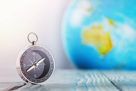 Travel compass and earth globus on wooden background. Journey, adventure lifestyle.Road to home.Trip. Archivio Fotografico