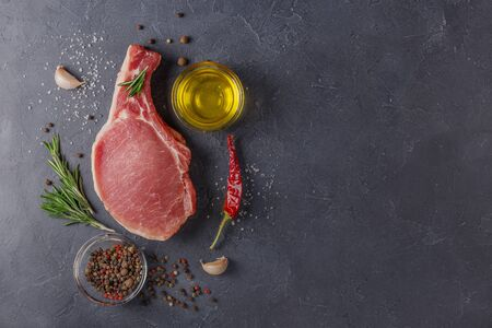 Meat  of juicy and fresh steak.Meat on a black stone . Stockfoto