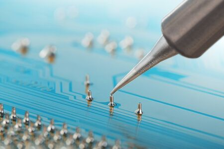 Soldering of electronic circuit board with electronic components. Soldering station. Engineers repair circuit board with soldering iron. Stockfoto