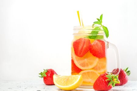 drink with strawberries, lemon and mint on a white background