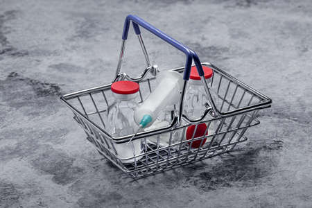 Shopping basket. Medical syringe for injection with a needle and medicine.