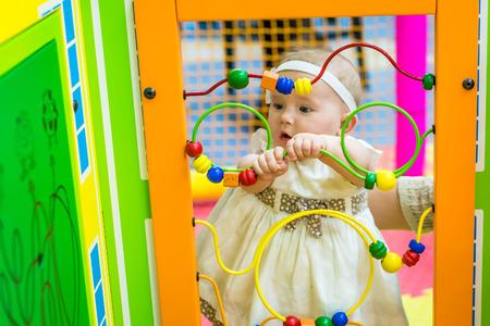 Baby in nursery Stock Photo