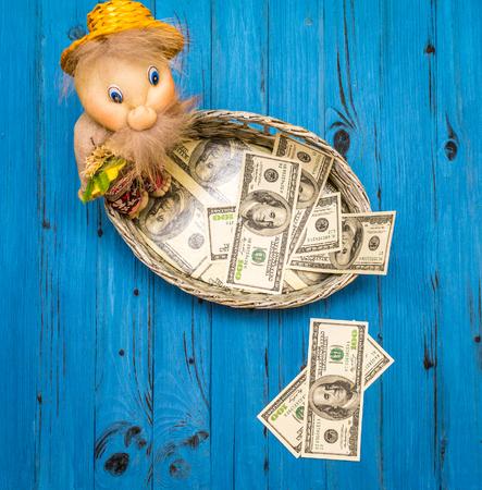 Dollar bills in a wicker basket