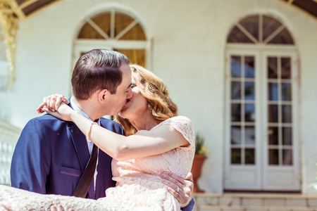 throw up: Groom holding bride in his arms Stock Photo