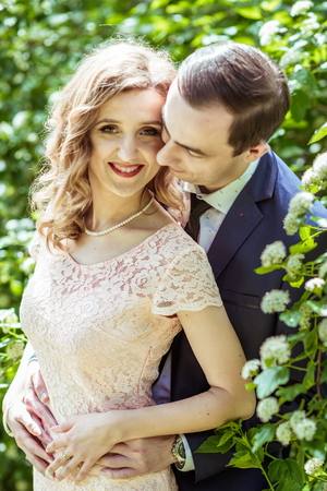 Cheerful couple in the meadow Stock Photo