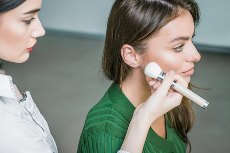 womanly: Woman applying cosmetic