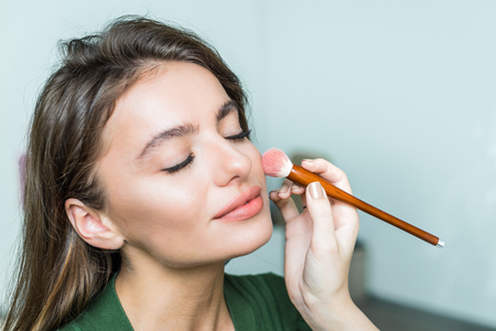 Woman applying cosmetic