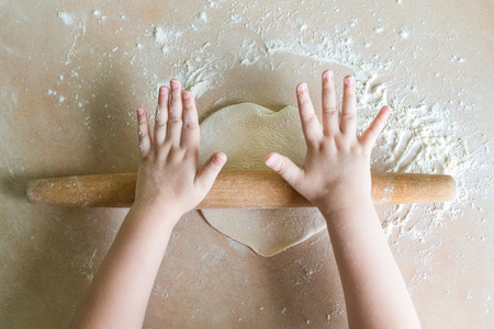 Childrens hands rolled dough