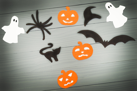 silueta de gato: Halloween holiday background with three pumpkins, cat, spider, bat, hat and two ghosts Foto de archivo