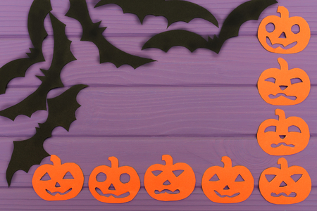 wood carvings: Halloween corner frame with pumpkin paper silhouettes and bats Stock Photo
