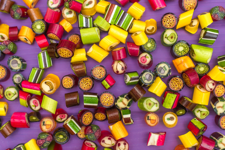 A pile of colorful caramel coated candies Stock Photo