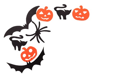 superstitious: Silhouettes of black volatile bats, cats, orange pumpkins, cats and spider carved out of black paper are isolated on white