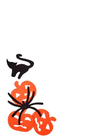 Silhouettes of orange pumpkins black cat and spider carved out of black paper are isolated on white Stock Photo