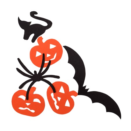 superstitious: Silhouettes of orange pumpkins black cat, bat and spider carved out of black paper are isolated on white
