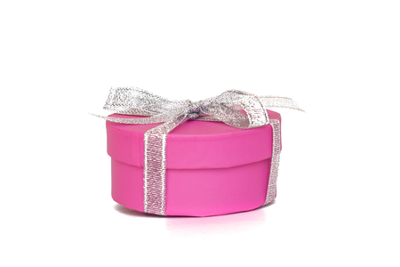 Pink gift box with white ribbon isolated on white