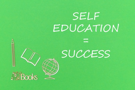 concept school for kids, text self education success, school supplies wooden miniatures on green backboard