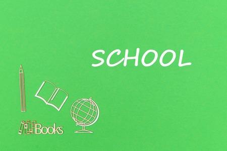 concept school for kids, text school, school supplies wooden miniatures on green backboard Stock Photo