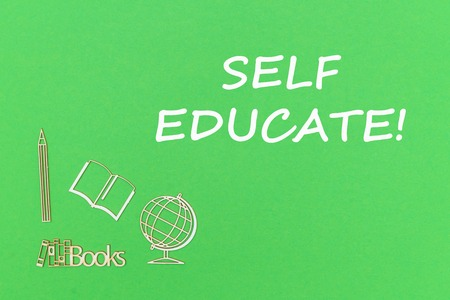 concept school for kids, text self educate, school supplies wooden miniatures on green backboard